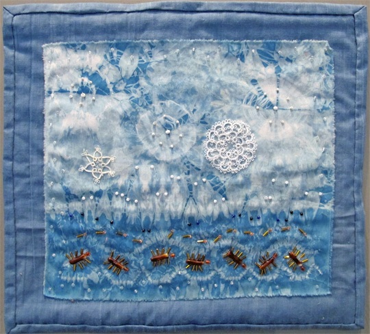 """Starry Sky and Ants. 2020, 14"""" wide x 12 ¾"""". Tie dyed indigo fabric with beads and crochet objects. $200"""